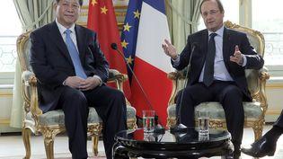 François Hollande et le président chinois Xi Jinping à l'Elysee à Paris, le 26 mars 2014. (CHRISTOPHE ENA / AFP)