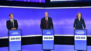 Nicolas Sarkozy, Alain Juppé etNathalie Kosciusko-Morizet, lors du dernier débat de la primaire à droite sur France 2, jeudi 18 novembre 2016. (CHRISTOPHE ARCHAMBAULT / AFP)