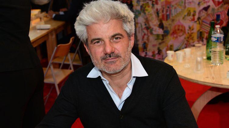 Le romancier Laurent Gaudé au Salon Livres Paris, mars 2019 (LAURENT BENHAMOU/SIPA)