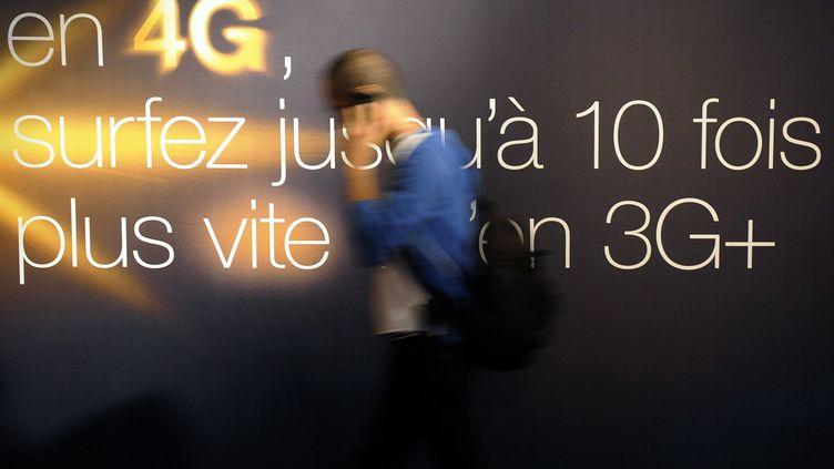 SFR a doublé ses concurrents en lançant le premier réseau 4G grand public à Lyon, le 28 novembre 2012. (FRANCK PENNANT / AFP)