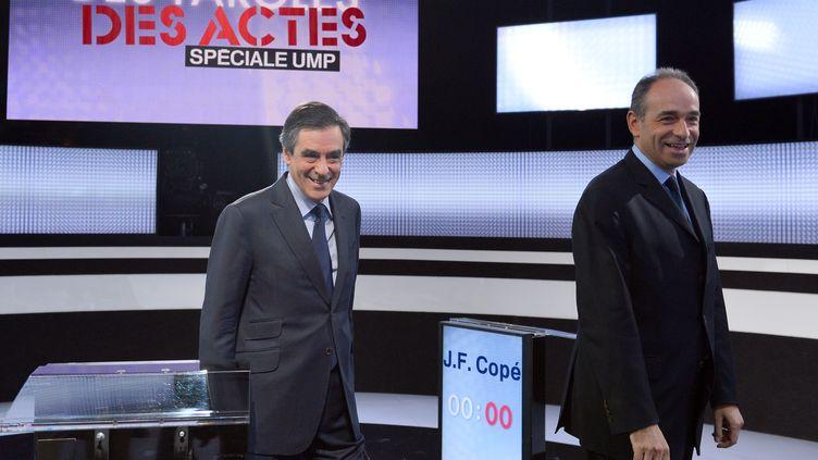 """Les deux candidats à la présidence de l'UMP, François Fillon et Jean-François Copé, le 25 octobre 2012 sur le plateau de """"Des paroles et des actes"""" sur de France 2. (MIGUEL MEDINA / AFP)"""