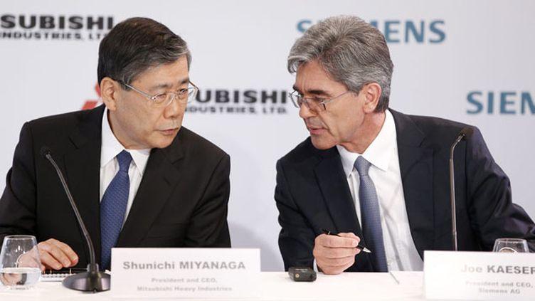 (Siemens et Mitsubishi à l'Elysée pour la conquête d'Alstom © Maxppp)