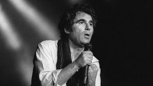 Claude Nougaro le 23 février 1983 au Palais des sports de Toulouse  (JEAN-PIERRE MULLER / AFP)