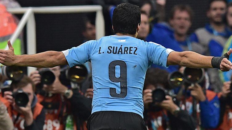 Luis Suarez touché par la grâce (NELSON ALMEIDA / AFP)