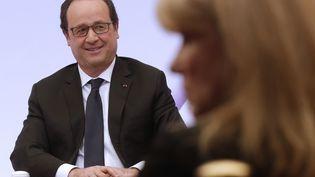 Le président François Hollande à l'Elysée, le 8 mars 2015. (CHRISTIAN HARTMANN / AFP)