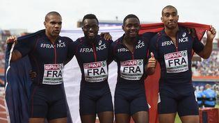 Les relayeurs français Marvin René, Stuart Dutamby, Mickael Zeze et Jimmy Vicaut,le 10 juillet 2016 à Amsterdam (Pays-Bas). (JOHN THYS / AFP)