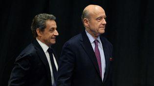 Nicolas Sarkozy et alain Juppé, le 14 octobre 2015 (NICOLAS TUCAT / AFP)
