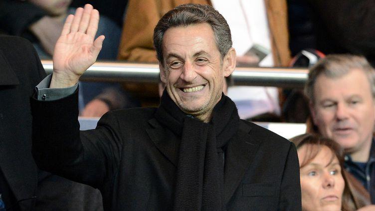 Nicolas Sarkozy dans les tribunes duParc des Princes lors d'un match du PSG, le 21 avril 2013, à Paris. (FRANCK FIFE / AFP)