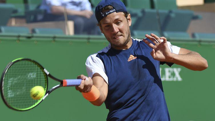Le joueur français Lucas Pouille (YANN COATSALIOU / AFP)