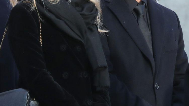 Laura Smet et David Hallyday, le 9 décembre 2017 aux obsèques de leur père à Paris. (LUDOVIC MARIN / AFP)