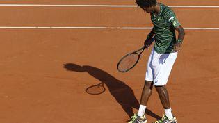 Gael Monfilsà Roland-Garros,après sa victoire sur l'Argentin Diego Schwartzman, le 27 mai 2015. (KENZO TRIBOUILLARD / AFP)