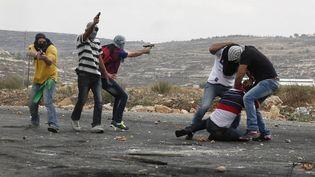 Des agents infiltrés et armés ont tiré lors d'une manifestation à Ramallah (Cisjordanie), le 7 octobre 2015. (ABBAS MOMANI / AFP)