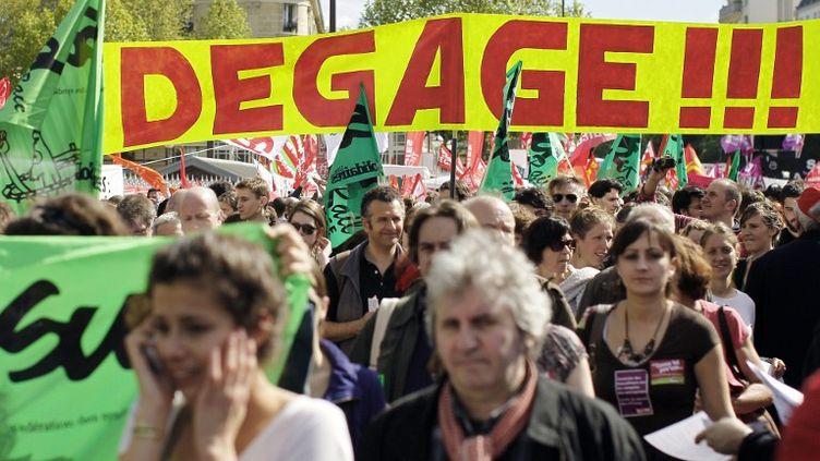Des manifestants dans le cortège syndical, le 1er mai 2012 à Paris. (THOMAS SAMSON / AFP)
