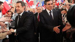 Nicolas Sarkozy et François Fillon arrivent à un meeting de la campagne présidentielle de Nicolas Sarkozy, le 25 avril 2012, à Cernay (Haut-Rhin). (  MAXPPP)