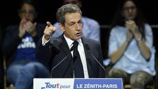 Nicolas Sarkozy prononce un discours, lors du meeting au zénith de Paris, dimanche 9 octobre 2016. (MIGUEL MEDINA / AFP)