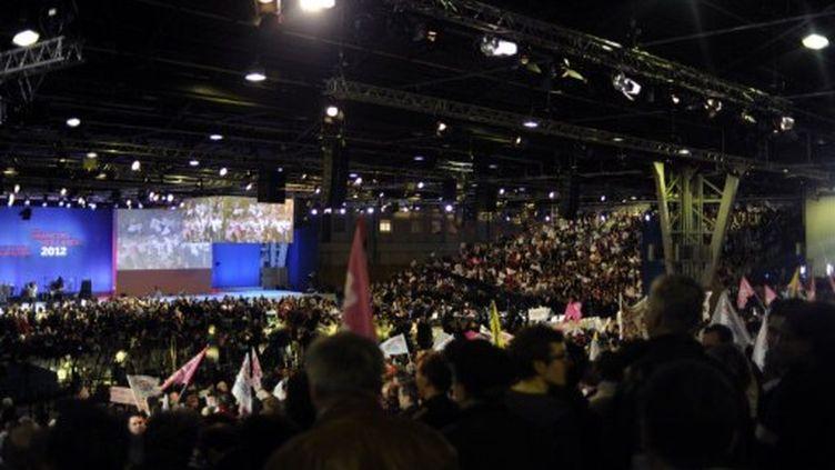 La salle du Bourget quelques minutes avant le discours de Hollande (FRED DUFOUR / AFP)