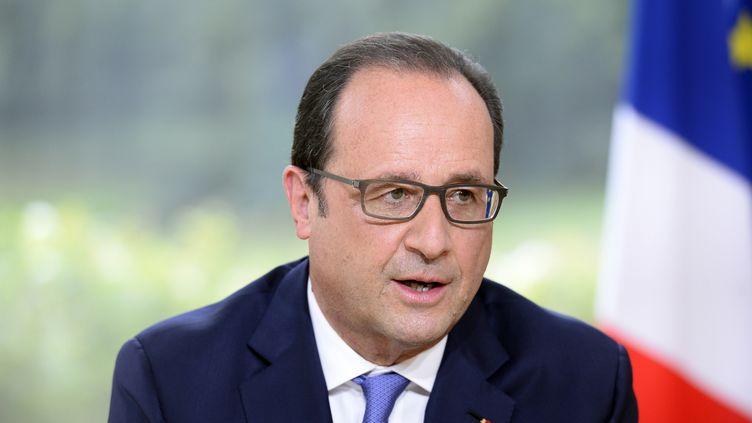 Le président François Hollande, le 14 juillet 2015, lors de son interview du 14-Juillet, à l'Elysée, à Paris. (  REUTERS)
