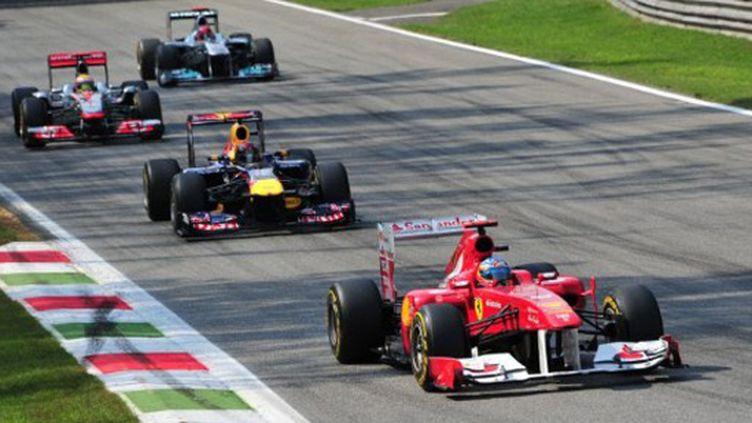 Alonso, Vettel, Hamilton et Schumacher : quatre champions du monde dans la même image. L'un des temps forts du GP d'Italie, 13e manche du championnat.