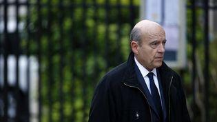 Le maire de Bordeaux lors des obsèques de l'ancien commissaire européen Jacques Barrot, à Paris, le 8 décembre 2014. (KENZO TRIBOUILLARD / AFP)