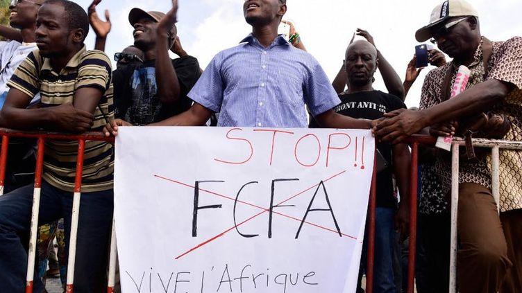 Manifestation contre le CFA, le 16 septembre 2017, à Dakar place de la Nation. (Seyllou/AFP)