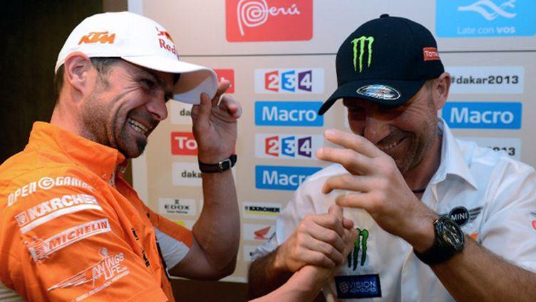 Cyril Desprès et Stéphane Peterhansel, les tenants du titre du Dakar en moto et en auto