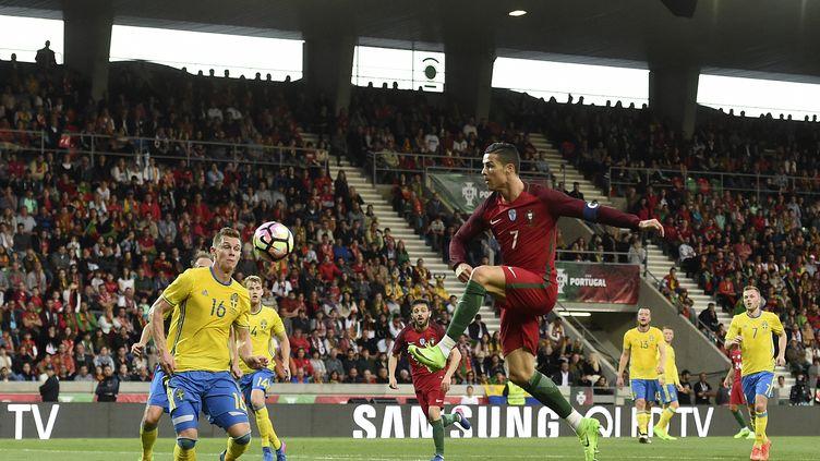 Cristian Ronaldo a ouvert le score pour le Portugal face à la Suède  (FRANCISCO LEONG / AFP)