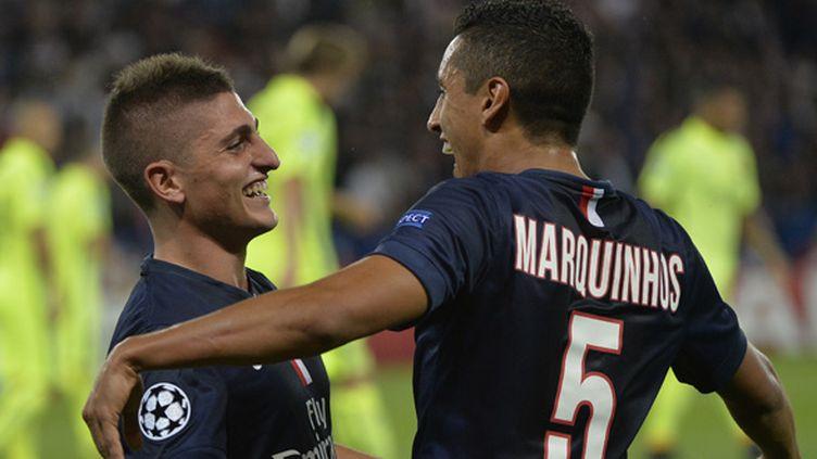 Marco Verratti et Marquinhos (PSG) tout sourire  (MIGUEL MEDINA / AFP)
