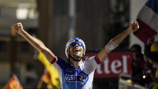 Thibaut Pinot remporte la 20e étape du Tour de France sur le col de l'Alpe d'Huez, samedi 25 juillet 2015. (ERIC FEFERBERG / AFP)