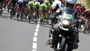Un motard du Tour de Franceà Montpellier (Hérault), le 13 juillet 2016. Photo d'illustration. (KENZO TRIBOUILLARD / AFP)