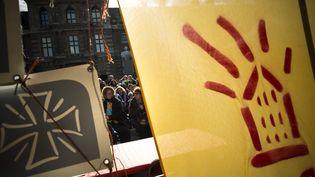 Rassemblement organisé par le DAL, le Secours catholique et la Fondation Abbé-Pierre à l'occasion du septième anniversaire de la loi sur le droit au logement opposable, le 5 mars 2014 à Paris. (  MAXPPP)