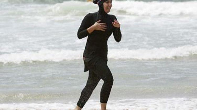 Une femme en burkini (© DR)