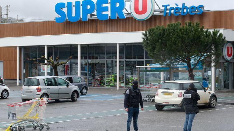 Le Super U de Trèbes (Aude) le lendemain de l'attaque, le 24 mars 2018. (ERIC CABANIS / AFP)