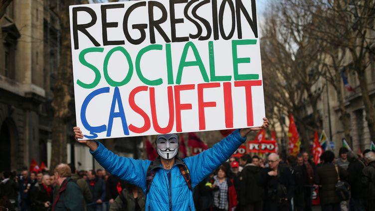 Lors d'une manifestation, le 5 mars 2013 à Paris. (THOMAS SAMSON / AFP)