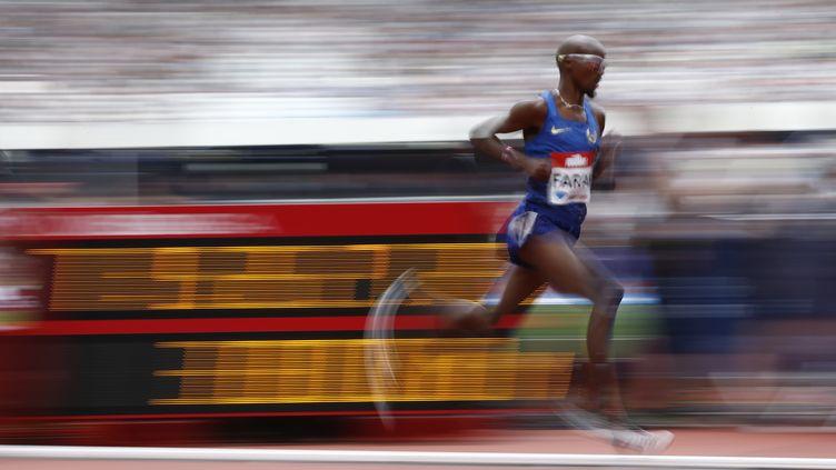 L'athlète anglais Mo Farah lors d'une épreuve de 5000 m à Londres le 23 juillet 2016. (ADRIAN DENNIS / AFP)