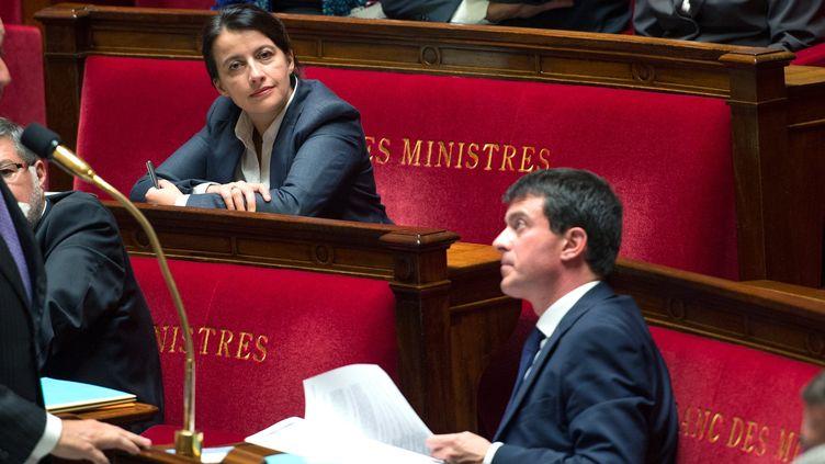 La ministre du Logement, Cécile Duflot, et le ministre de l'Intérieur, Manuel Valls, le 1er octobre 2013 à l'Assemblée nationale, à Paris. (LCHAM / SIPA)