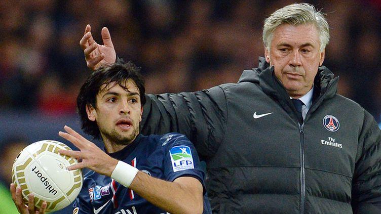 Javier Pastore sous les yeux de Carlo Ancelotti (FRANCK FIFE / AFP)