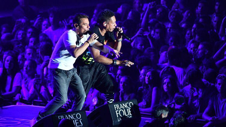 Joey Starr et Kool Shen se sont produits jeudi 12 juillet sur la scène des Francofolies à La Rochelle. (XAVIER LEOTY / AFP)