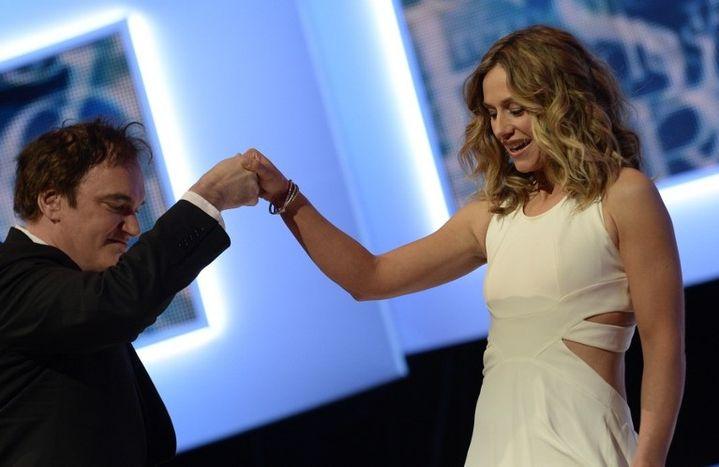 Cécile de France accueille Quentin Tarantino aux 39e Césars le 28 février 2014  (MARTIN BUREAU / AFP)