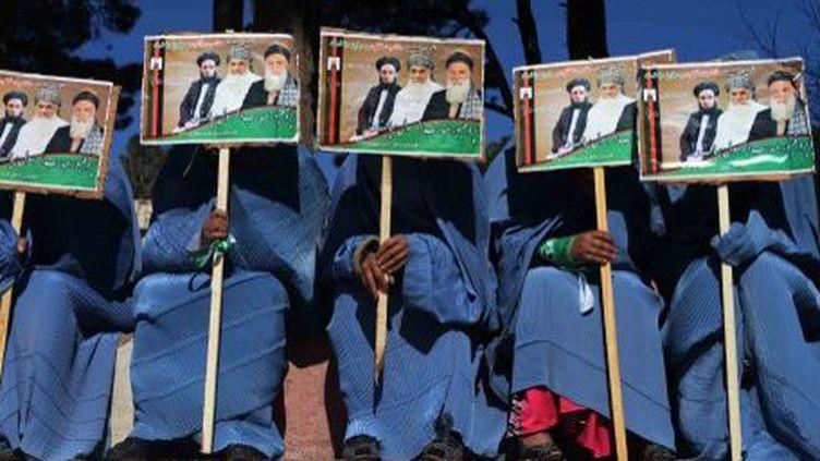 Hérat, Afghanistan, le 25 mars 2014. Supportrices de candidats a l'élection présidentielle du 5 avril 2014.  (TOPSHOTS/AFP PHOTO/AREF KARIMI)