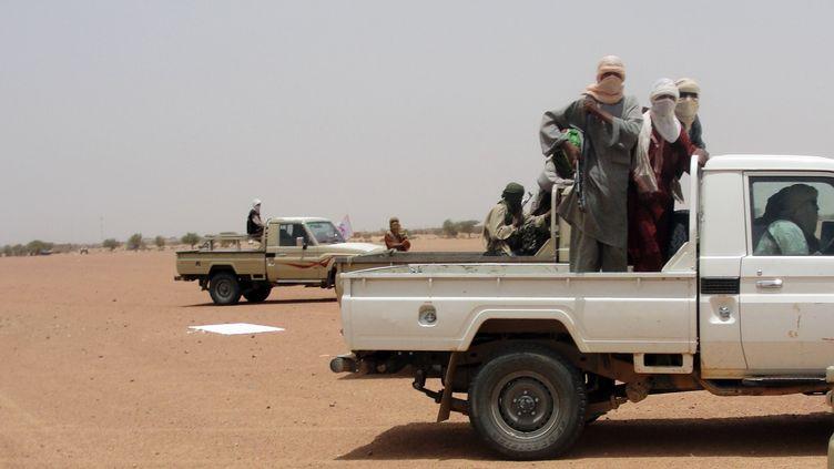 Des combattants d'Ansar Dine, dans la région de Kidal (nord du Mali), le 7 août 2012. (ROMARIC HIEN / AFP)