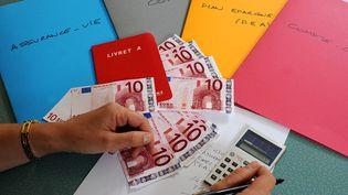 Le stock d'épargne gérée dans le cadre des contrats d'assurance-vie s'élevait à 1 405,5 milliards d'euros fin février 2013. (PHILIPPE CHEREL / MAXPPP)