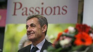 """Nicolas Sarkozy dédicace son livre """"Passions"""", à Montpellier (Hérault), le 18 décembre 2019. (NICOLAS GUYONNET / HANS LUCAS / AFP)"""