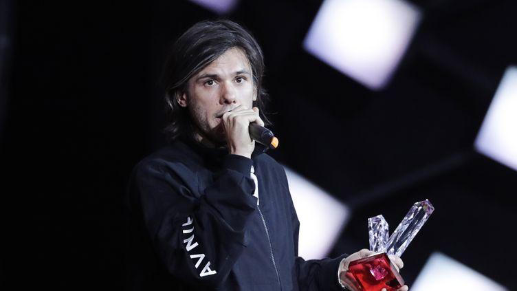 Orelsan, le 9 février 2018, lors des 33es Victoires de la musique, à la Seine Musicale de Boulogne-Billancourt (Hauts-de-Seine). (THOMAS SAMSON / AFP)