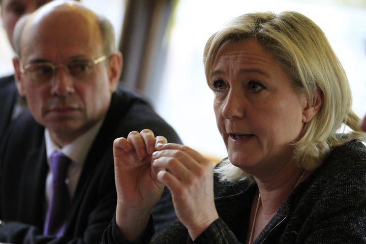 Jean-Luc Schaffhauser (à gauche) et Marine Le Pen, le 26 février 2014. (HERVE KIELWASSER / MAXPPP)