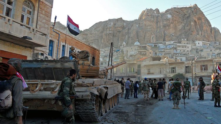 Des troupes de Bachar Al-Assad dans le village chrétien de Maalula(Syrie), le 11 septembre 2013. ( AFP)