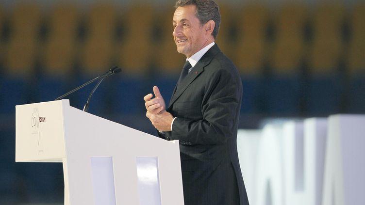 L'ancien président de la République Nicolas Sarkozy, le 11 décembre 2012 à Doha (Qatar). (KARIM JAAFAR / AL-WATAN DOHA / AFP)