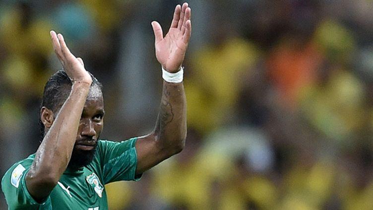 Didier Drogba, à sa sortie du terrain, à l'issue du dernier match de poule des Éléphants lors de la Coupe du Monde 2014. (ARIS MESSINIS / AFP)