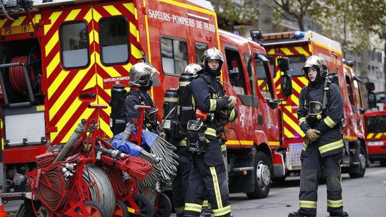 Des pompiers à Paris le 22 octobre 2014. (KENZO TRIBOUILLARD / AFP)