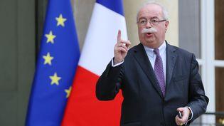 L'ancien patron de Total Christophe de Margerie quitte le Palais de l'Elysée à Paris le 21 janvier 2014. (KENZO TRIBOUILLARD / AFP)
