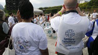Des bénévoles du Secours catholique lors des 70 ans de l'association. (MATTHIEU ALEXANDRE / AFP)